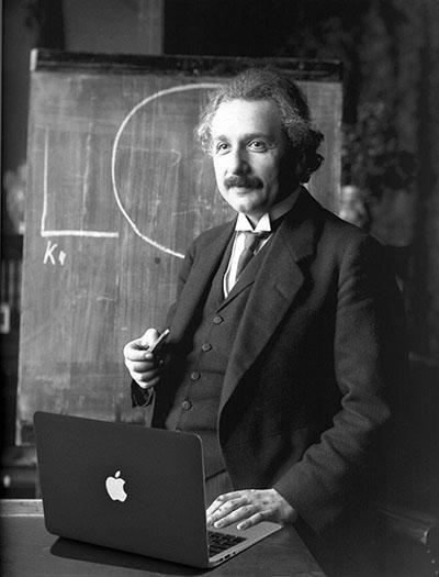 Albert Einstein using MacBook