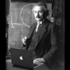 Albert Einstein using MacBook